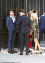 Niall Horan looks sharp in a chequered suit and white shirt as he celebrates