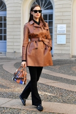Irina Shayk shows off her narrow waist in a leather trench coat