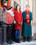 Emmy Rossum belts out Christmas carols as she joins Oscar winner