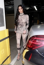 Kim Kardashian slips her jaw-dropping curves into a skintight unitard
