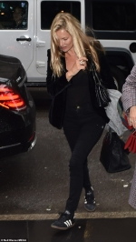 Kate Moss embraces a rock 'n' roll look in black velvet blazer and skinny
