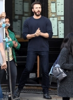 Chris Evans looks handsome in a navy sweater and jeans as he films scenes