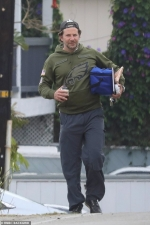 Bradley Cooper represents his hometown of Philadelphia while heading to a beach party in Malibu