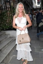 Michelle Mone puts on a busty display in a cream gown with racy lace panels