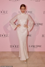 Millie Mackintosh exudes glamour in a sparkling ivory gown as she attends