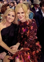 Big Little Lies' Reese Witherspoon enjoys a reunion with co-star Nicole Kidman at the CMA Awards...