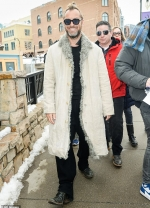 Jude Law goes for retro styling in funky tinted shades and a shearling