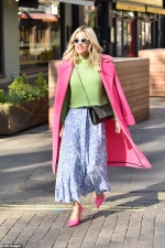 Ashley Roberts looks chic as she colour clashes in bright pink coat
