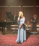 Pregnant Katy Perry puts on a soulful performance in a flowing light blue gown...