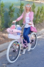 Paris Hilton makes her pet pooch Princess the centerpiece of her pink ensemble during