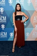 Lily Aldridge parades her toned legs in a daring slit dress as she presents