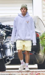 Justin Bieber oozes casual-cool in yellow shorts and hoodie as he heads back to the recording studio in LA...