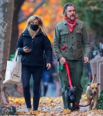 Ethan Hawke, 50, looks effortlessly cool in a green military-style jacket as he and his wife