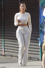 Draya Michele dazzles in wintry off-white ensemble as she films