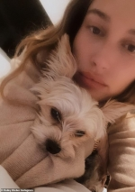 Hailey Bieber snuggles with her dog Oscar as she shares some gorgeous