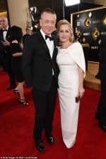 The Crown's Gillian Anderson looks ravishing in a red gown as she wins