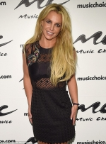 Britney Spears wears black leather undies and over-the-knee boots