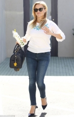 Reese Witherspoon rocks a casual cool outfit including sweater and jeans in LA...