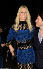Claudia Schiffer wears sheer paneled dress as she poses