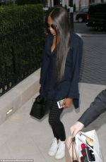 Naomi Campbell keeps a low-profile in navy blue shirt and polka dot leggings