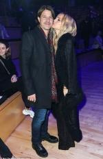 Rachel Zoe plants a kiss on husband Rodger Berman's cheek at Brandon Maxwell's