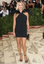 Kate Moss, 44, oozes glamour in a chic black dress with flamboyant feathered
