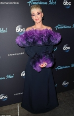 Katy Perry steals the spotlight in an ombre purple feather gown