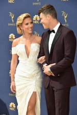 Scarlett Johansson dazzles in plunging white gown as she leads best dressed