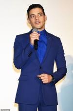 Rami Malek looks sharp in electric blue as he joins Bohemian Rhapsody
