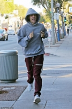 Justin Bieber looks excited as he sprints to massage after leaving