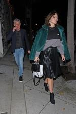 Katharine McPhee, 34, stuns in green velvet jacket and leather skater skirt