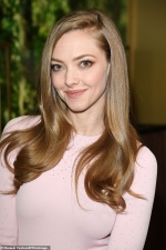 Amanda Seyfried is pretty in stylish pale pink dress at luxury watch expo