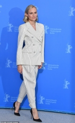 Diane Kruger cuts an elegant figure in pinstripe suit as she joins co-stars