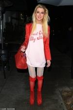 Tara Reid celebrates Valentine's Day with racy red lace stockings