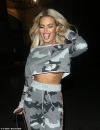 Megan Barton-Hanson flashes a hint of underboob in a cropped camouflage
