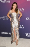 Billie Lourd glams up in a slinky feathered metallic dress as she attends