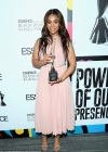Regina Hall dons pink pleated dress and receives trophy at Essence Black