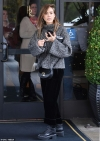 Jessica Alba cuts a casual figure in cosy grey jumper and velvet trousers