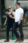 Amy Schumer shows off her blossoming bump during stroll with husband Chris Fischer in New Orleans