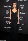 Nina Dobrev turns heads in a chic black jumpsuit as she attends