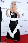 Lady Gaga is a gift in black leather and white as she flaunts her cleavage