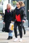 Mel C enjoys a relaxing shopping trip with mum Joan O'Neill in London...