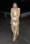 Jaime King nails androgynous chic in metallic gold blazer and matching flowy trousers