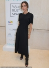 Victoria Beckham keeps it simple in demure black dress as she makes