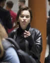 Emilia Clarke cuts a casual figure in a leather jacket as she touches down