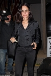 Courteney Cox is stylish in silky black blouse and skinny
