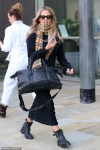 Caroline Flack steps out in a stylish black jumper and midi skirt
