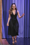 Jessica Alba shows plenty of cleavage in a black dress as the actress