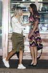 Caitlyn Jenner, 69, dazzles in multi-coloured zigzag print dress as she joins partner Sophia Hutchins