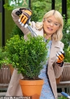Holly Willoughby giggles as she 'trims the best bush' in innuendo-filled